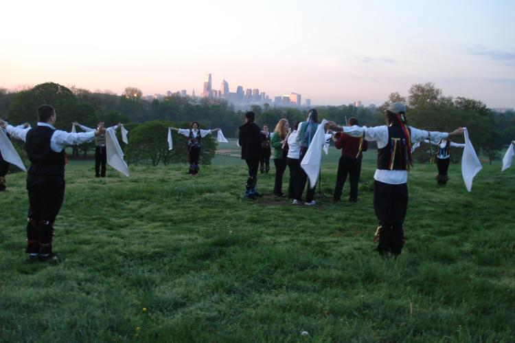 Arms spread, hankies out, the sun rising over Philadelphia